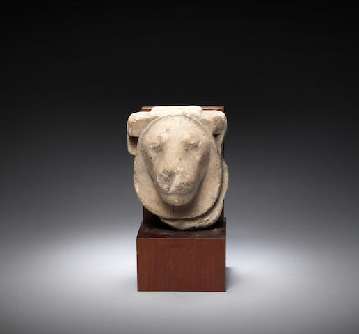 An Egyptian limestone head of a lion