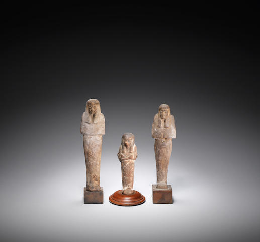 Two Egyptian wood shabtis and an Egyptian terracotta shabti 3
