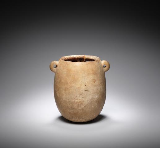 An Egyptian breccia miniature storage vessel