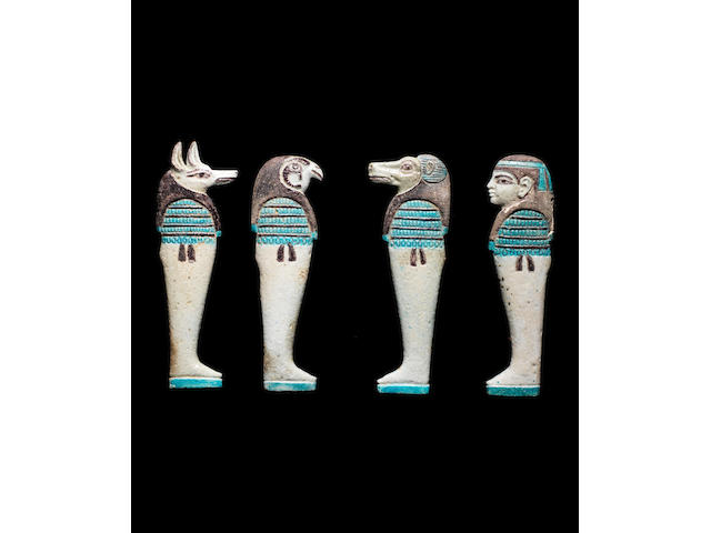 Four Egyptian glazed composition 'Sons of Horus' 4