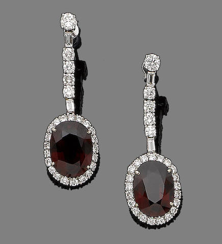 A pair of garnet and diamond pendent earrings,