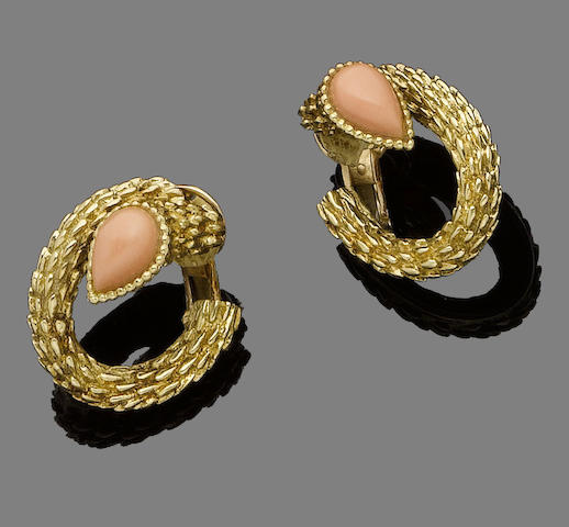 A pair of gold and coral earclips, by Boucheron,