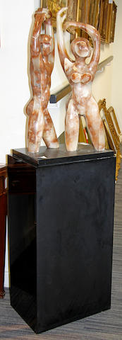 Two soapstone figures on an ebonised plinth