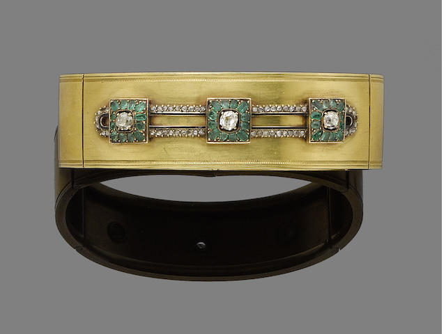 An emerald and diamond bangle,