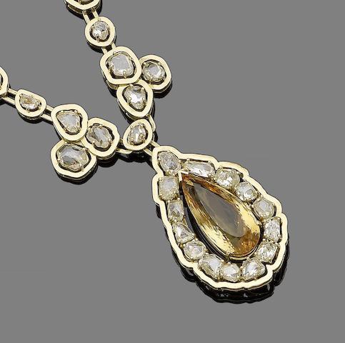 A topaz and diamond pendant necklace