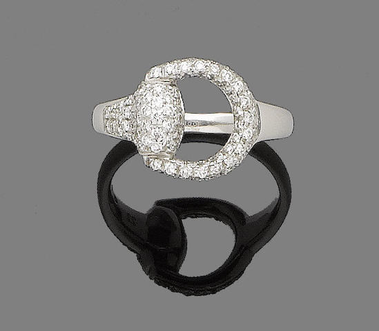 A diamond-set ring, by Gucci