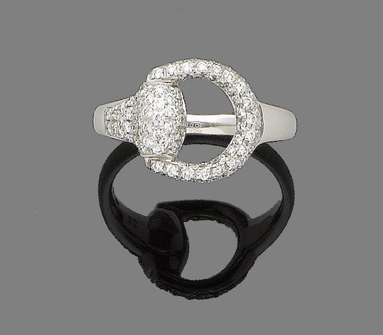 A diamond-set ring, by Gucci