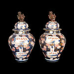 A pair of 19th century Imari porcelain urns