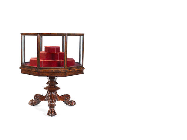 A George IV carved rosewood octagonal display case on tripod stand