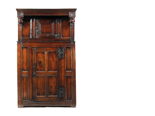 A Charles II oak press/food cupboard (possibly later elements)