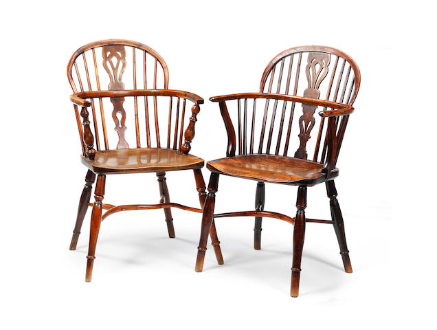 A harlequin set of six mid-19th century yew low back Windsor armchairs