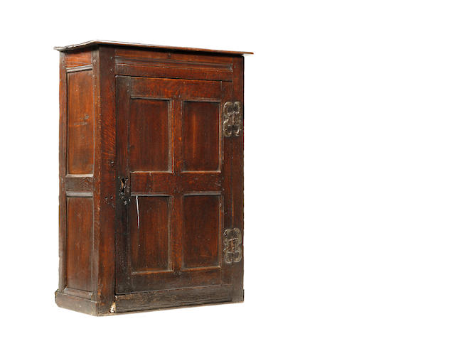 An early 18th century oak hanging cabinet