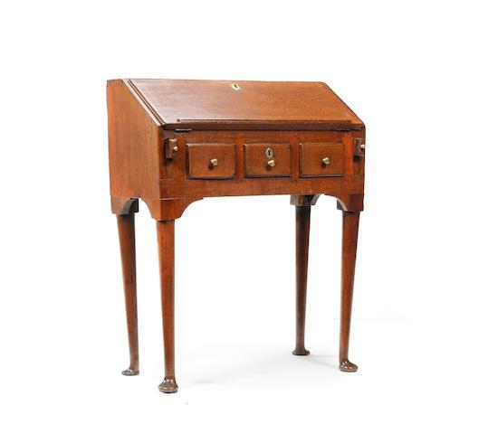 A small George I oak bureau