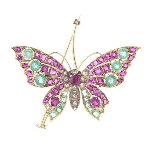 An emerald, pink sapphire and diamond butterfly brooch (illustrated above)