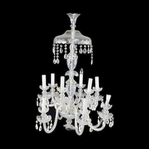 A cut and moulded glass twelve light chandelier