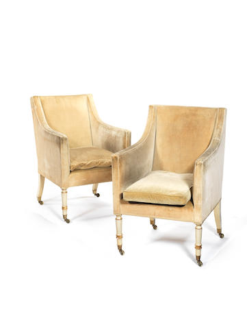 A Pair of Regency white painted upholstered bergere armchairs