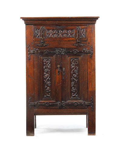 A 17th century and later oak cabinet, Flemish