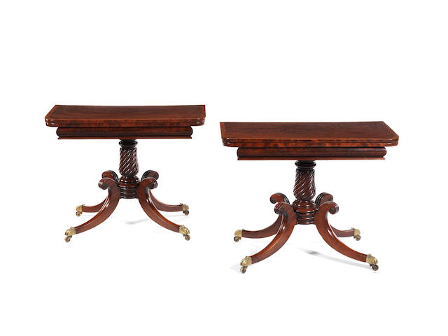A pair of Regency Scottish (?) mahogany and amboyna(?) crossbanded 'D' shaped card tables