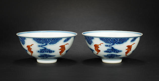 A pair of underglaze blue and iron-red decorated bowls Xuantong six-character marks