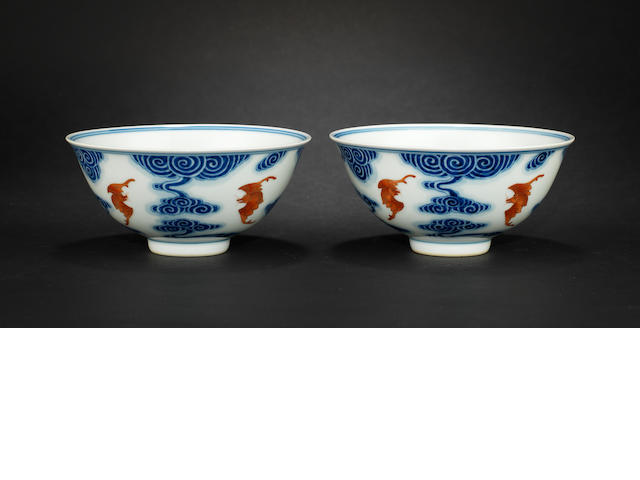 A pair of underglaze blue and orange decorated bowls Xuantong six-character marks