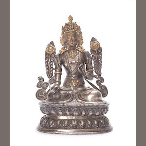 a Silver repousse figure of Tara, 18th century, some sections missing