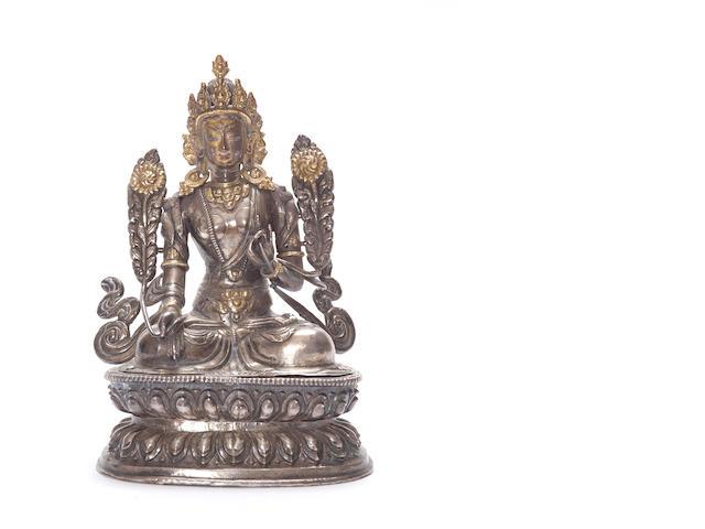 A silver repoussé figure of Tara 18th century
