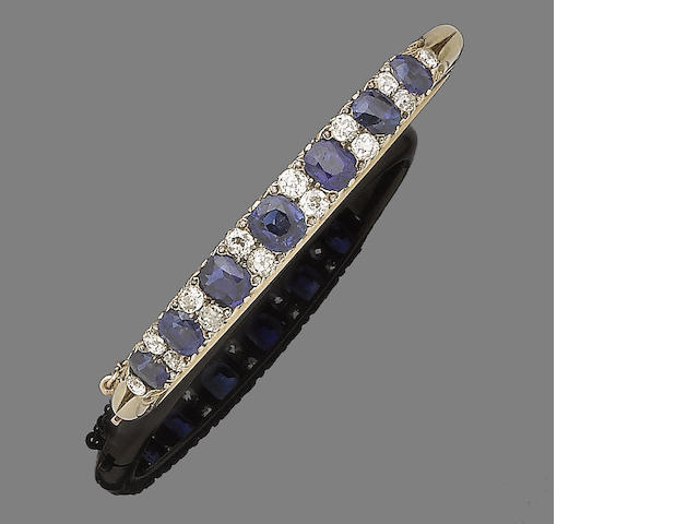 A sapphire and diamond bangle,