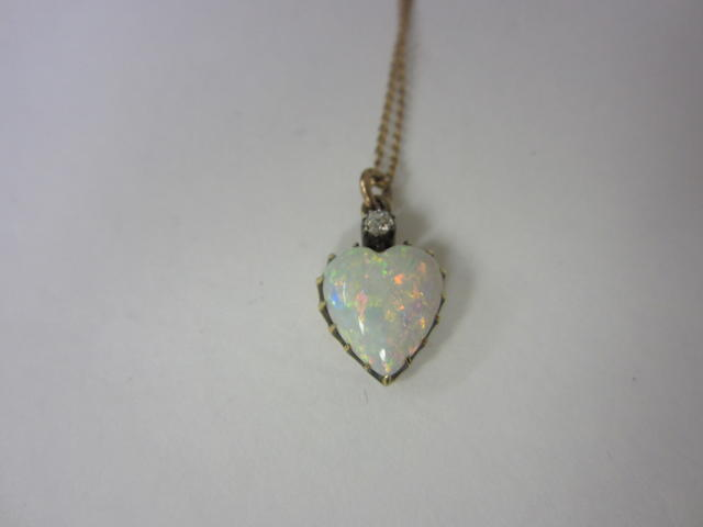 A Victorian opal and diamond pendant