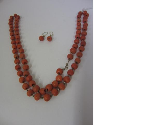 A faceted coral bead necklace