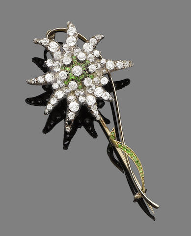 A demantoid garnet and diamond flower brooch,
