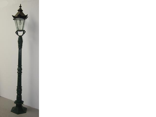 A set of four reproduction Victorian-style cast iron street lamps,