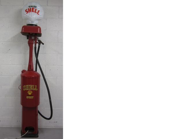 A Bowser hand cranked petrol pump,
