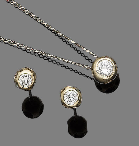 A diamond pendant necklace and earstud suite