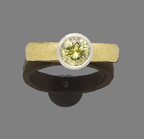 A fancy greenish yellow diamond single-stone ring, by Malcolm Betts,