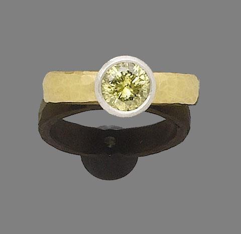 A fancy greenish yellow diamond single-stone ring, by Malcolm Betts,