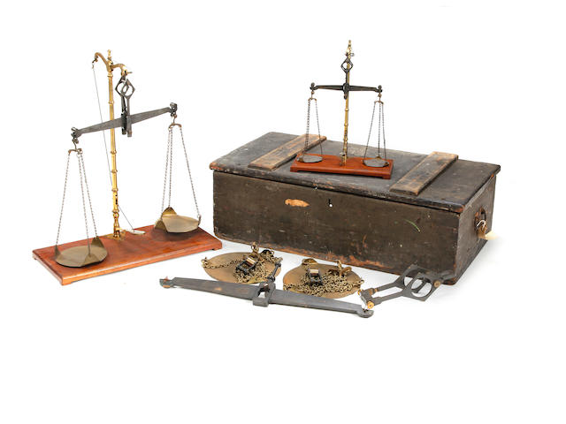A set of three late Victorian brass and agate beamscales, to weigh 56lb, 7lb and 1lb, for the County of Cumberlandby Doyle & Son, London