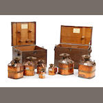 A boxed set of seven copper and brass 'Chekpump' petrol measures, circa 1930, for the County of CumberlandAll marked 'Serial No. 112/1930'