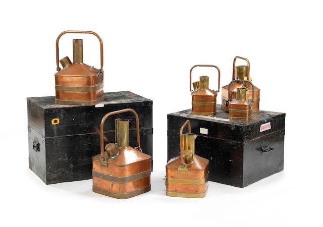 A boxed set of six copper and brass petrol measures, circa 1931, for the County Borough of Barrow-in-Furnessby W. & T. Avery Ltd., London