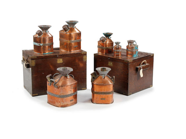 A set of seven brass and copper 'Chekpump' petrol measures, circa 1930, for the County of CumberlandAll marked 'Serial No. 111'
