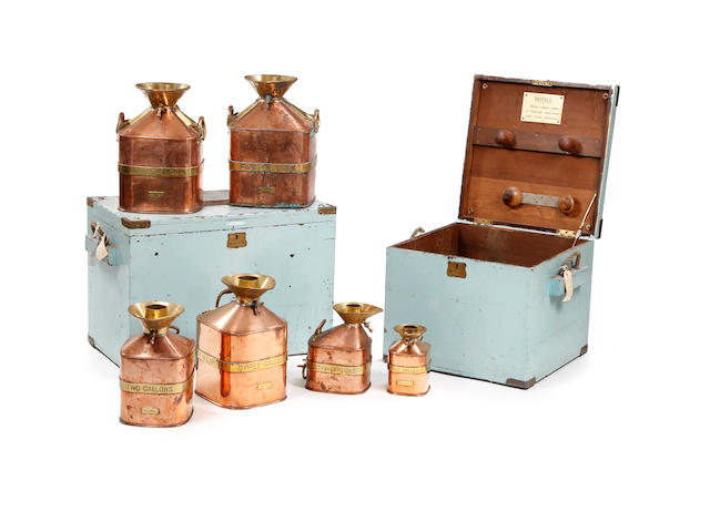 A boxed set of six copper and brass 'Chekpump' petrol measures, circa 1930, for the City of Carlisle All marked 'Serial No. 109'