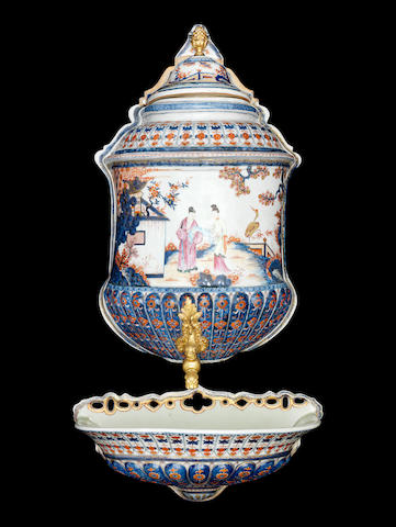 A famille rose and Chinese Imari wall-mounted cistern and cover The cistern and cover 18th century, the basin Samson