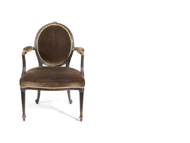 A George III beechwood armchair attributed to Chippendale