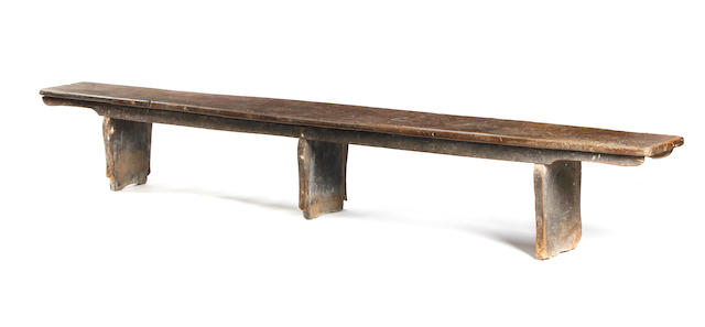 An 18th century elm boarded bench