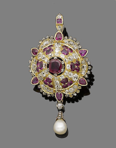A ruby and diamond brooch/pendant,
