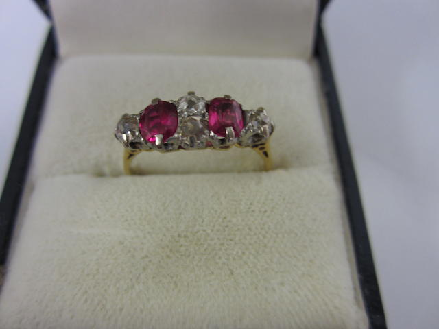 A six stone ruby and diamond ring