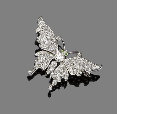 A diamond and demantoid garnet brooch,
