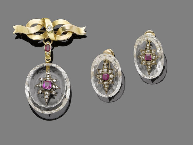 A late 19th century rock crystal, ruby and diamond brooch and earring suite (2)