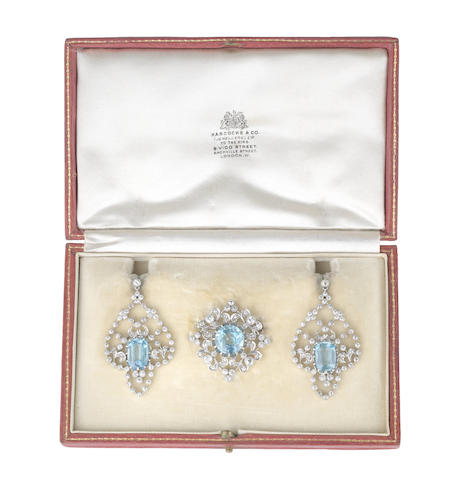 An aquamarine and diamond brooch and pendent earring suite (2) (illustrated above)