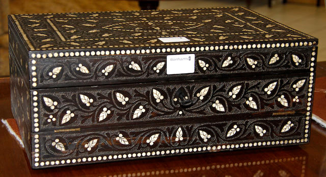 An early 20th Century bone inlaid, ebony triple-fold writing slope,