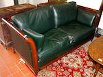 A Gadelux polished beech framed and green leather upholsted three piece suite,